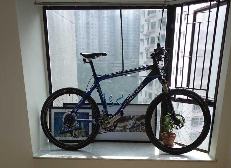 A bike kept in the window bay of a Hong Kong high-rise