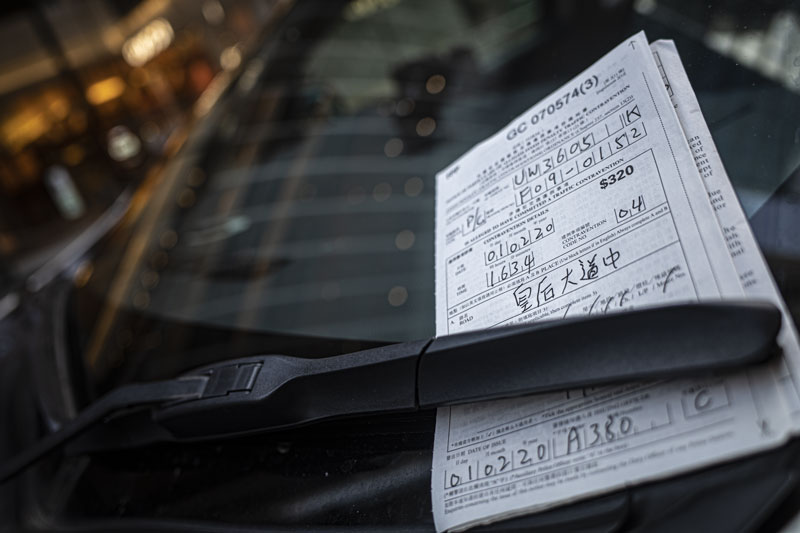 A Hong Kong parking ticket behind the windscreen of an illegally parked car in central Hong Kong