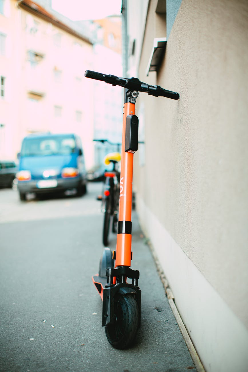 An orange electric scooter