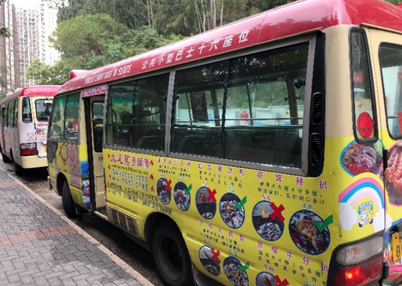A red-roofed minibus on trial under the Hong Kong govermnment's Pilot Green Transport Fund Scheme