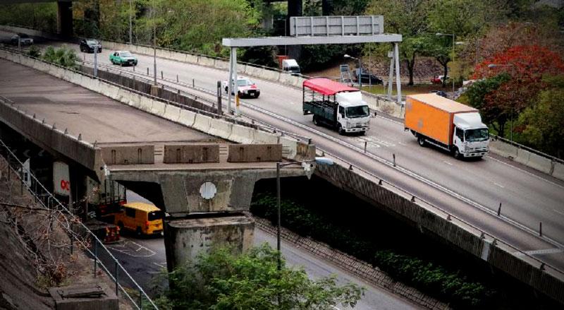 A half-completed road bridge adjacent to a highway