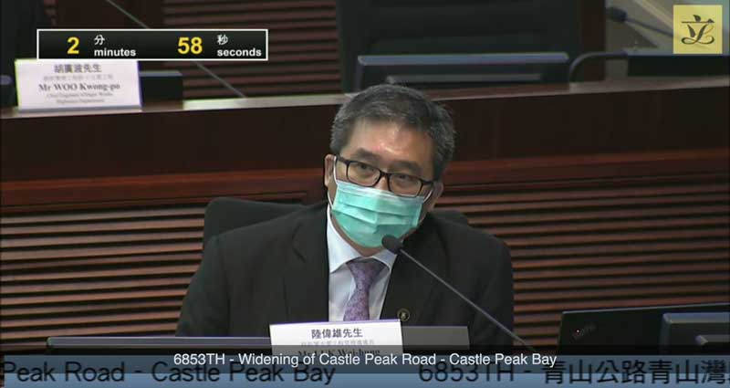 LUK Wai-hung of the Hong Kong Highways Department defends a road widening project in Hong Kong's Legislative Council