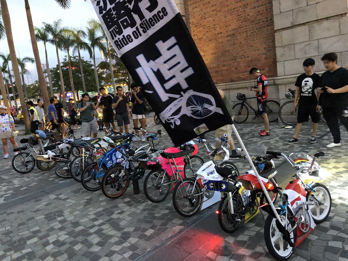 A line of small modified BMX bikes carry a Ride of Silence flag to honour those cyclists killed and injured in 2019