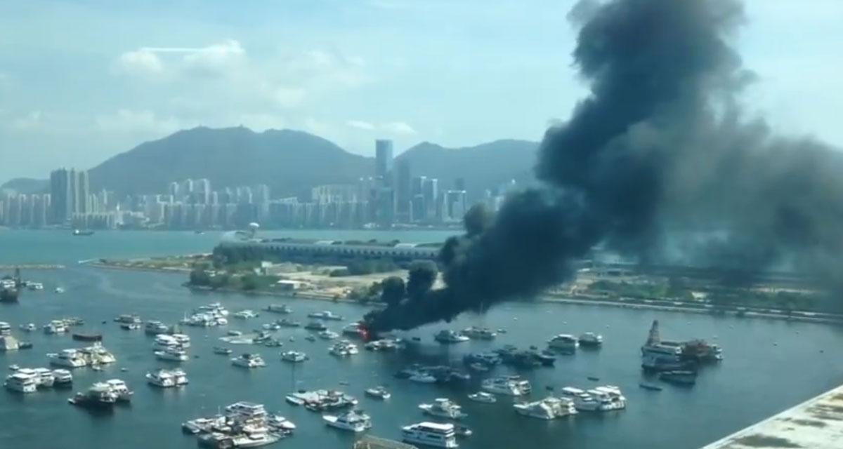 A boat burns in Kwun Tong Typhoon Shelter, Kowloon Bay