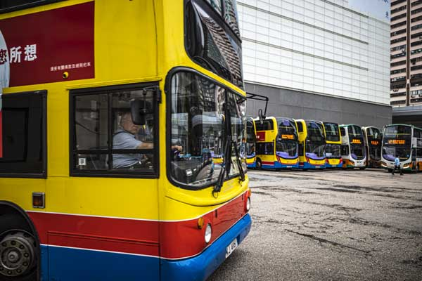 A bus driver pulls into the Sheung Wan bus park