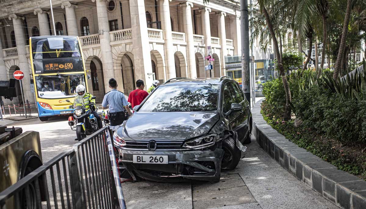 A smashed up Volkswagen Gold Sportsvan on a footpath outside Hong Kong's Court of Final Appeal