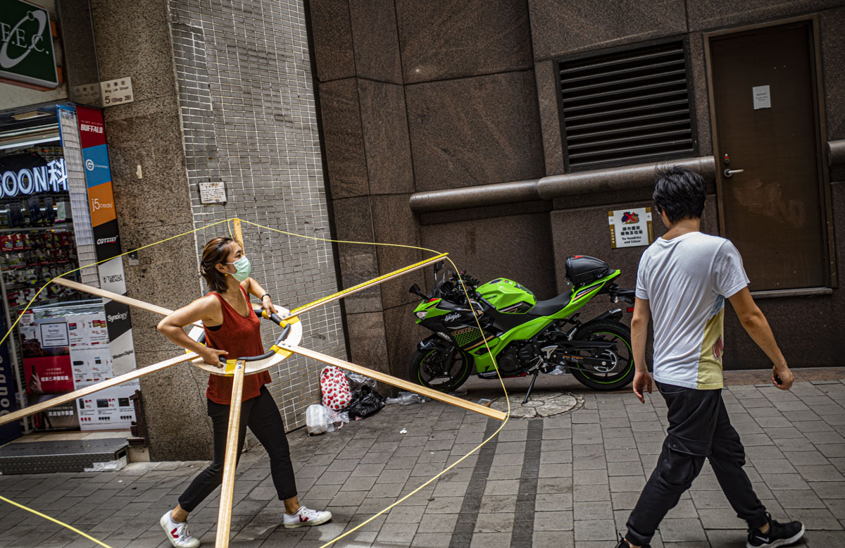 Walkability activists try out the social distancing machine in central Hong Kong