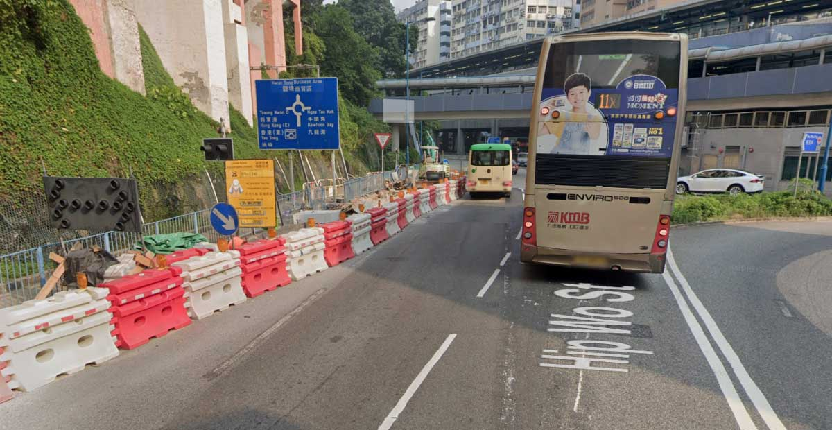 A busy roundabout in Hong Kong, with roadworks and a bus