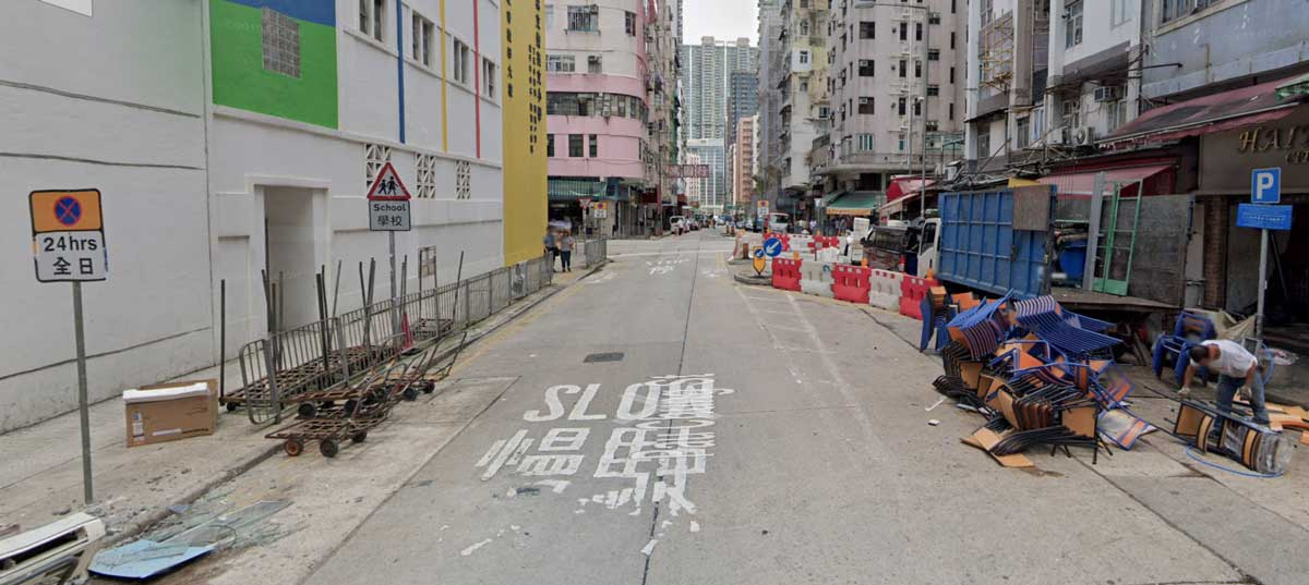 A street in Hong Kong with many obstacles and barriers to visibility