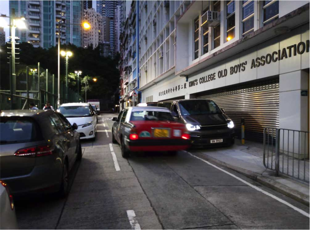 Cars pile along a lane and the footpath on this dead-end lane