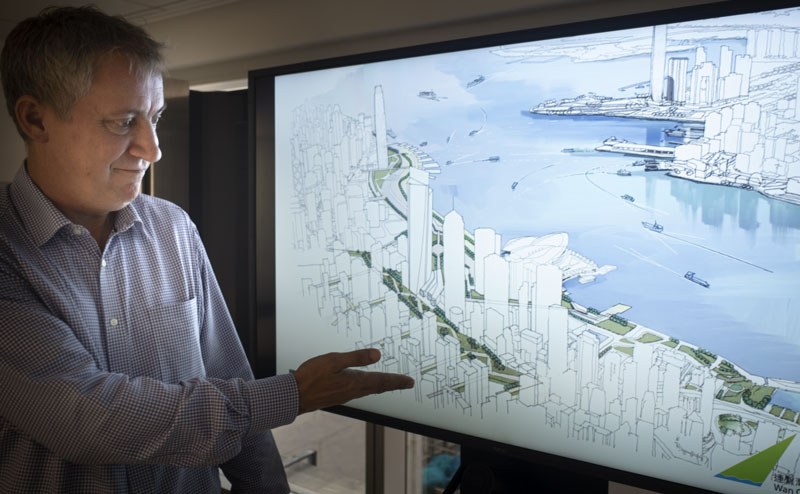 Buro Happold's Peter Dampier showing new plans for Wan Chai