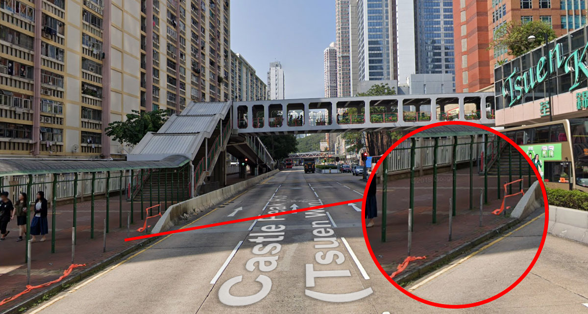 Missing railings and a pedestrian footbridge where a man was knocked down and killed by a taxi in Hong Kong June 22
