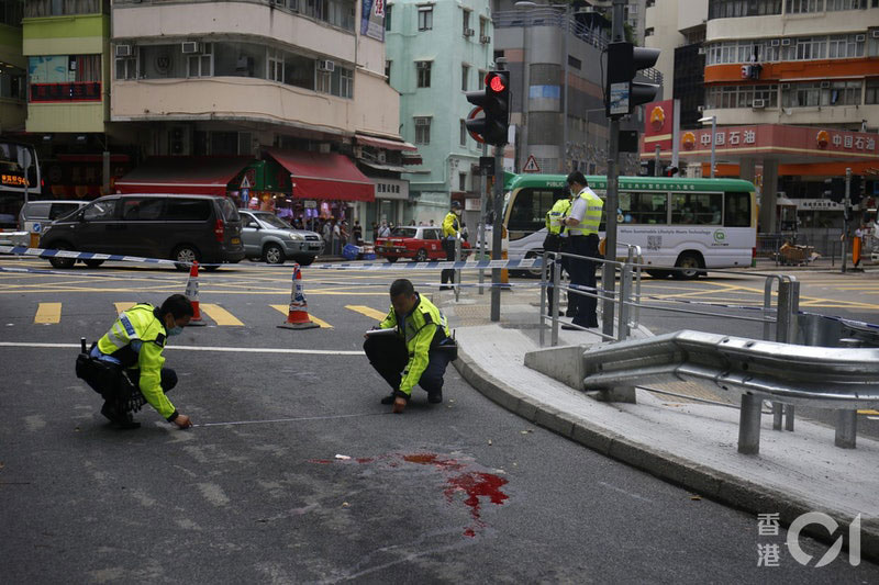 POlice check a bloodstained road after a traffic incident in Aberdeen