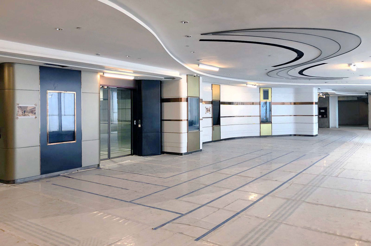 A new bus station in Kwun Tong, with doors seperating buses and passengers and modern swirly designs